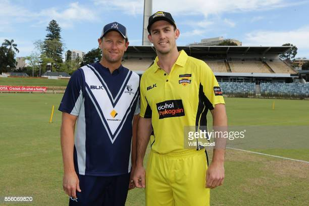 Cameron White of the Bushrangers and Mitchell Marsh of the Warriors after the look on at the coin toss prior to toss during the JLT One Day Cup match...