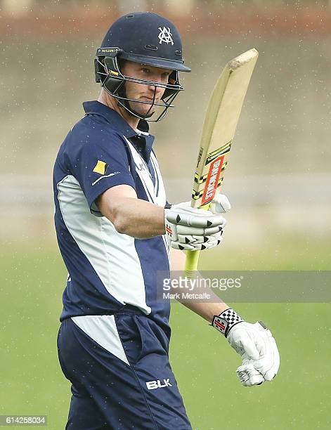 Cameron White of the Bushrangers celebrates and acknowledges the crowd after scoring a century during the Matador BBQs One Day Cup match between...