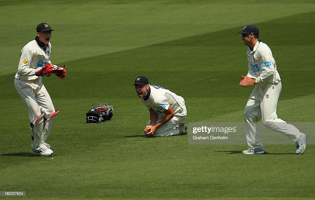 <a gi-track='captionPersonalityLinkClicked' href=/galleries/search?phrase=Cameron+White&family=editorial&specificpeople=178931 ng-click='$event.stopPropagation()'>Cameron White</a> of the Bushrangers (C) celebrates catching out Dominic Michael of the Bulls during day four of the Sheffield Shield match between the Victorian Bushrangers and the Queensland Bulls at Melbourne Cricket Ground on February 21, 2013 in Melbourne, Australia.