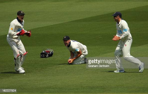 Cameron White of the Bushrangers celebrates catching out Dominic Michael of the Bulls during day four of the Sheffield Shield match between the...