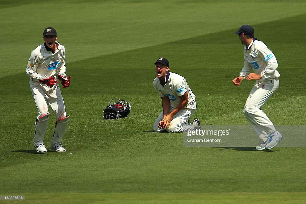 Cameron White of the Bushrangers (C) celebrates catching out Dominic Michael of the Bulls during day four of the Sheffield Shield match between the Victorian Bushrangers and the Queensland Bulls at Melbourne Cricket Ground on February 21, 2013 in Melbourne, Australia.
