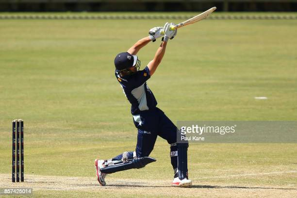 Cameron White of the Bushrangers hits a six during the JLT One Day Cup match between Victoria and Tasmania at WACA on October 4 2017 in Perth...