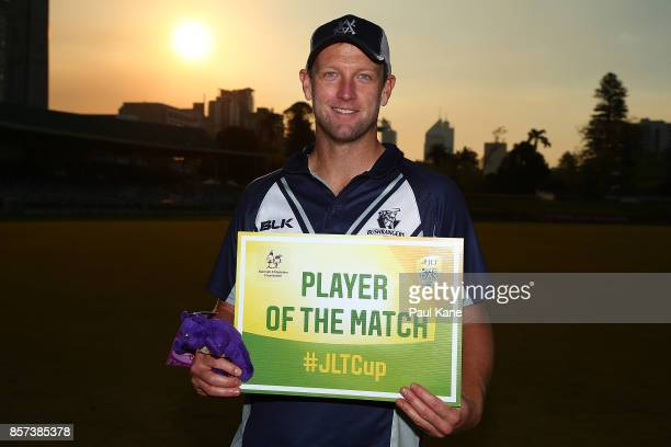 Cameron White of the Bushrangers poses with the Player of the Match award after winning the JLT One Day Cup match between Victoria and Tasmania at...