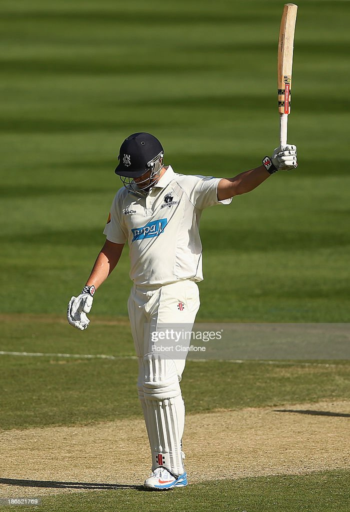 <a gi-track='captionPersonalityLinkClicked' href=/galleries/search?phrase=Cameron+White&family=editorial&specificpeople=178931 ng-click='$event.stopPropagation()'>Cameron White</a> of the Bushrangers raises his bat after scoring fifty runs during day three of the Sheffield Shield match between the Victoria Bushrangers and the Western Australia Warriors at Melbourne Cricket Ground on November 1, 2013 in Melbourne, Australia.