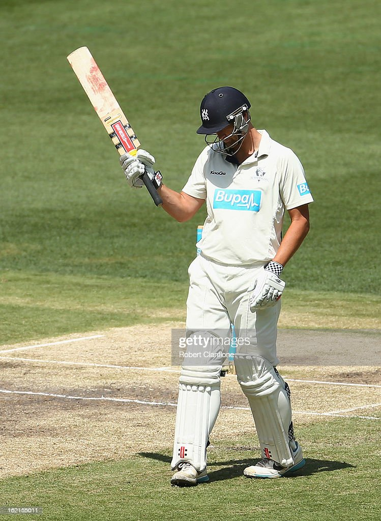 Cameron White of the Bushrangers raises his bat after scoring his century during day three of the Sheffield Shield match between the Victorian Bushrangers and Queensland Bulls at the Melbourne Cricket Ground on February 20, 2013 in Melbourne, Australia.