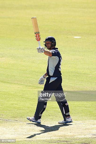 Cameron White of the Bushrangers raises his bat after scoring his century during the Matador BBQs One Day Cup match between South Australia and...