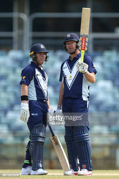 Cameron White of the Bushrangers raises his bat to the rooms after reaching his half century during the JLT One Day Cup match between Victoria and...