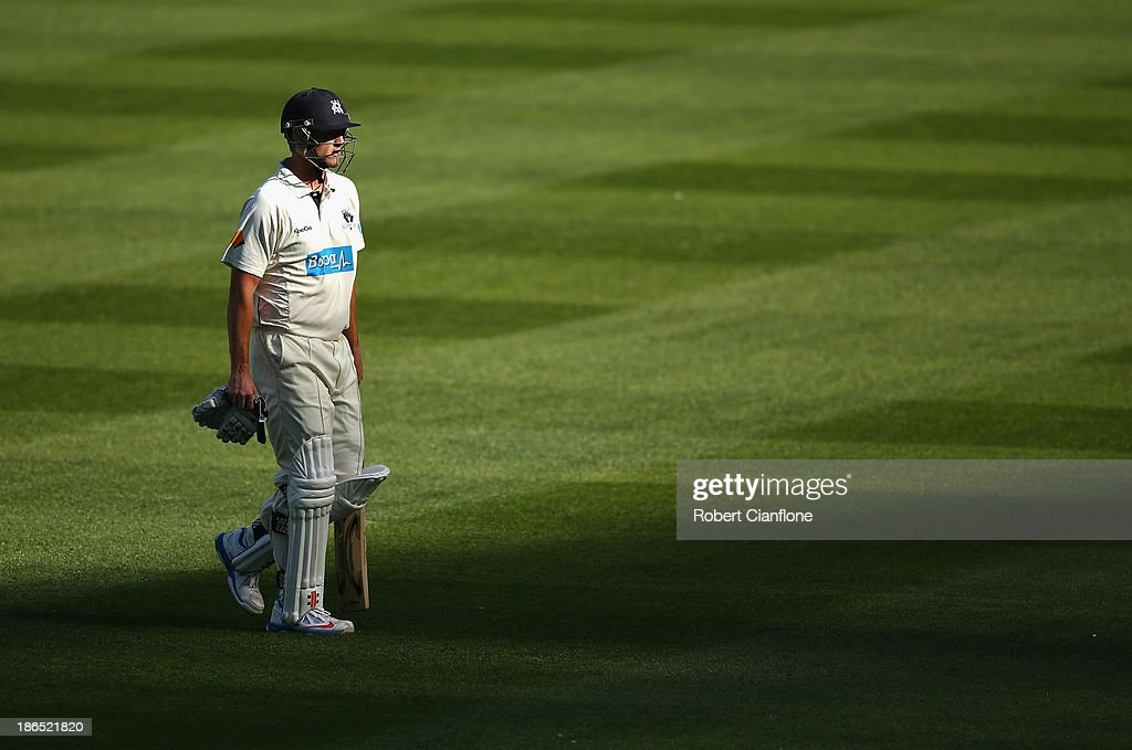 Cameron White of the Bushrangers walks from the ground after he was dismissed during day three of the Sheffield Shield match between the Victoria Bushrangers and the Western Australia Warriors at Melbourne Cricket Ground on November 1, 2013 in Melbourne, Australia.