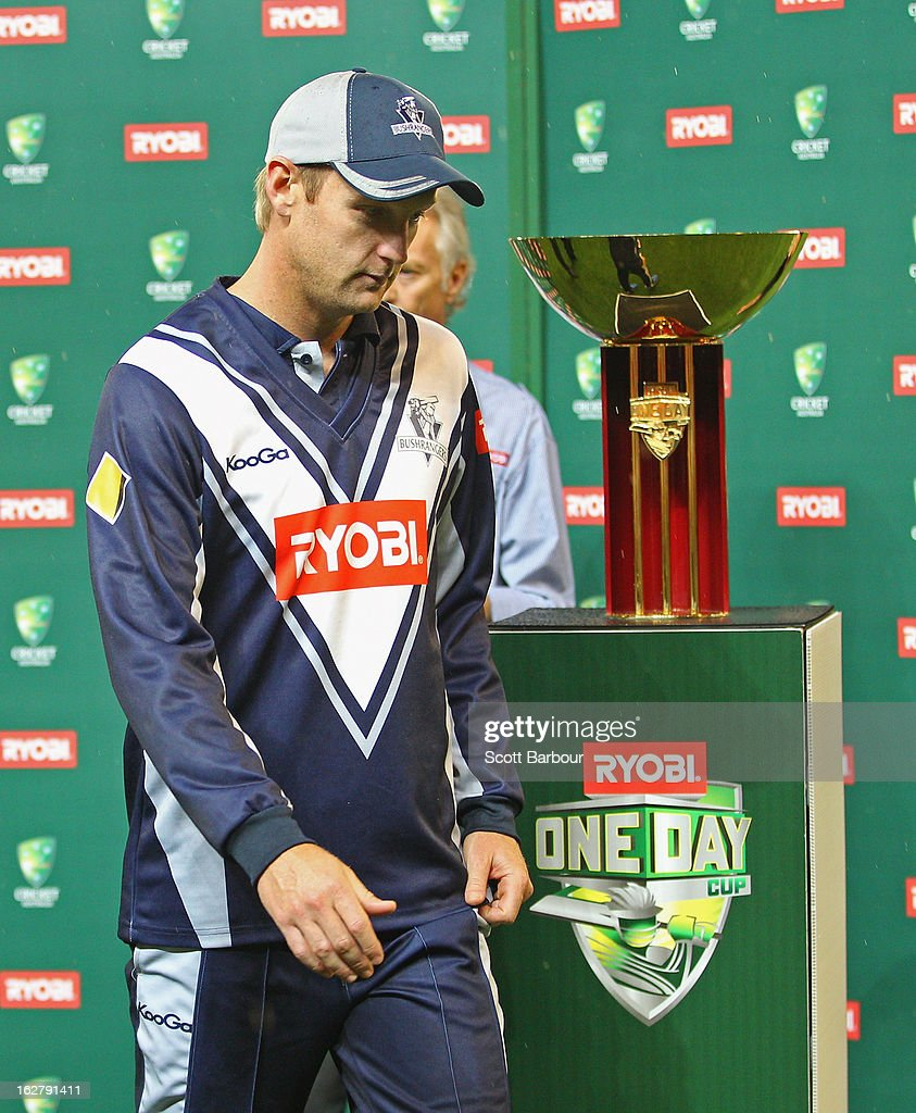 Cameron White of the Bushrangers walks past the trophy during the presentations after the Ryobi One Day Cup final match between the Victorian Bushrangers and the Queensland Bulls at Melbourne Cricket Ground on February 27, 2013 in Melbourne, Australia.