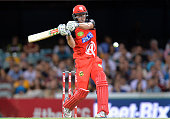 Cameron White of the Renegades plays a shot during the Big Bash League match between the Brisbane Heat and the Melbourne Renegades at The Gabba on...