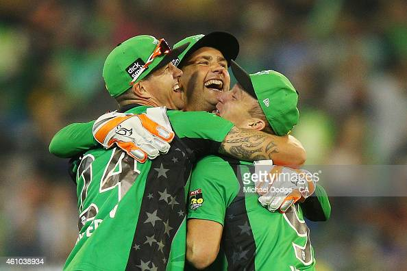 Cameron White of the Stars celebrates his catch with Kevin Pietersen and Tom Triffitt in their super over during the Big Bash League match between...
