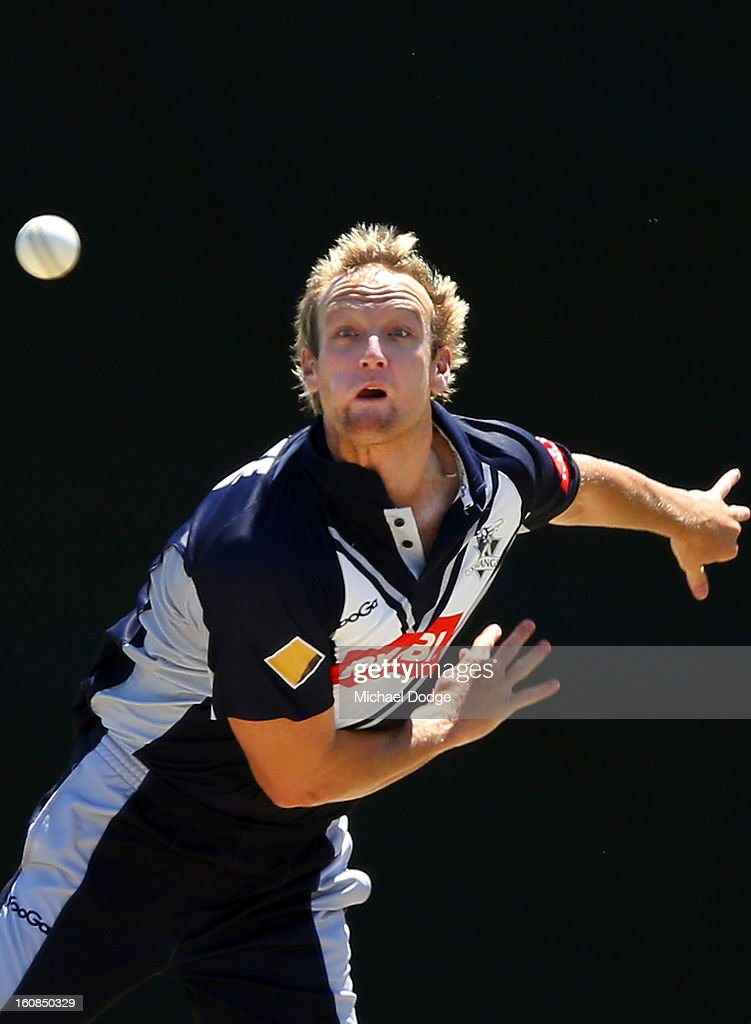Cameron White of Victoria bowls during the International tour match between the Victorian 2nd XI and the England Lions at Junction Oval on February 7, 2013 in Melbourne, Australia.