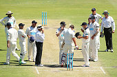 Cameron White of Victoria checks the helmet of Tom Beaton of Western Australia after being struck in the head by a delivery by Dan Christian as other...