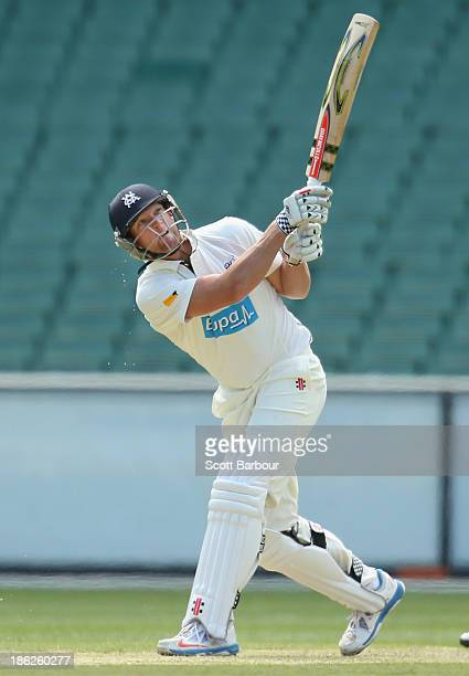 Cameron White of Victoria hits a boundary during day one of the Sheffield Shield match between the Victoria Bushrangers and the Western Australia at...