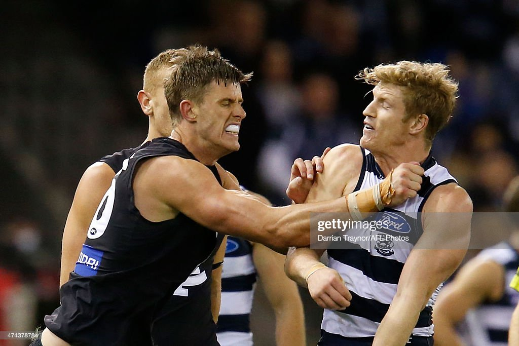 Cameron Wood of the Blues and Josh Caddy of the Cats wrestle during the round eight AFL match between the Geelong Cats and the Carlton Blues at Etihad Stadium on May 22, 2015 in Melbourne, Australia.