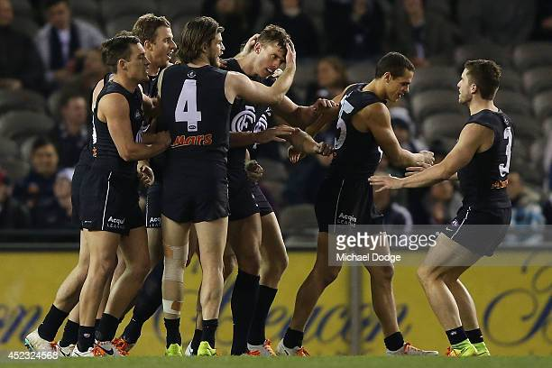 Cameron Wood of the Blues celebrates a goal with teamates during the round 18 AFL match between the Carlton Blues and the North Melbourne Kangaroos...