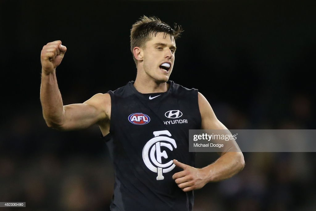 Cameron Wood of the Blues celebrates victory on the final siren during the round 18 AFL match between the Carlton Blues and the North Melbourne Kangaroos at Etihad Stadium on July 18, 2014 in Melbourne, Australia.