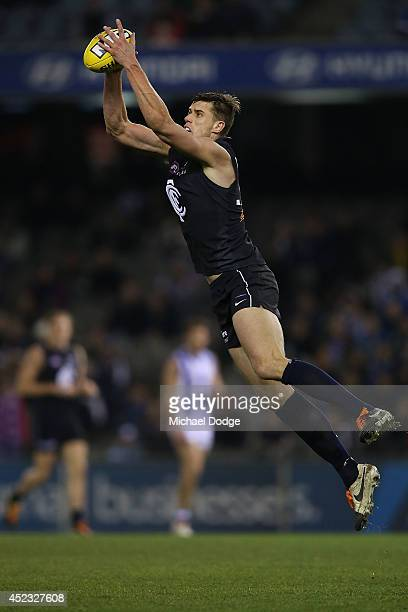 Cameron Wood of the Blues marks the ball during the round 18 AFL match between the Carlton Blues and the North Melbourne Kangaroos at Etihad Stadium...