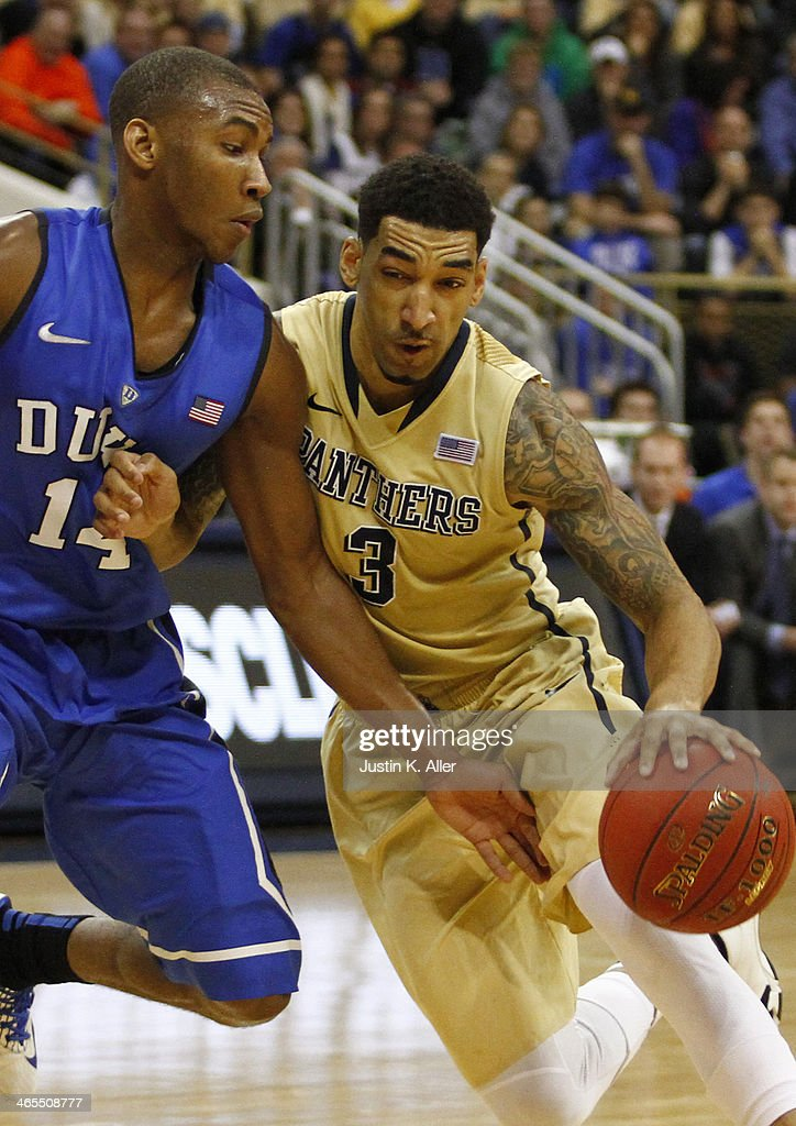 Cameron Wright #3 of the Pittsburgh Panthers drives the ball against <a gi-track='captionPersonalityLinkClicked' href=/galleries/search?phrase=Rasheed+Sulaimon&family=editorial&specificpeople=7887134 ng-click='$event.stopPropagation()'>Rasheed Sulaimon</a> #14 of the Duke Blue Devils at Petersen Events Center on January 27, 2014 in Pittsburgh, Pennsylvania.