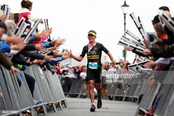 Cameron Wurf of Australia celebrates winning IRONMAN Wales on September 10 2017 in Tenby Wales