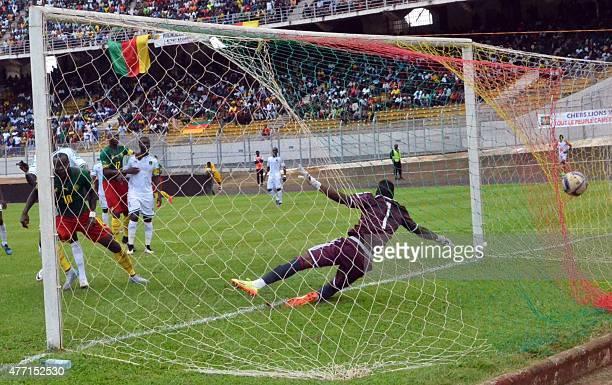 Cameron's player Vincent Aboubacar scores a goal against Mauritania goalkeeper Ibrahim Soulyemane on June 14 2015 at the Mamadou Ahidjo stadium in...