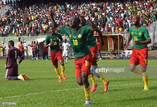 Cameron's players celebrates their goal against Mauritania on June 14 2015 at the Mamadou Ahidjo stadium in Yaounde during 2017 African Cup of...