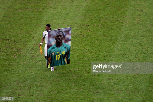 Cameroon captain Rigobert Song with a photograph of teammate and friend MarcVivien Foe who tragically died on the pitch in the previous match before...
