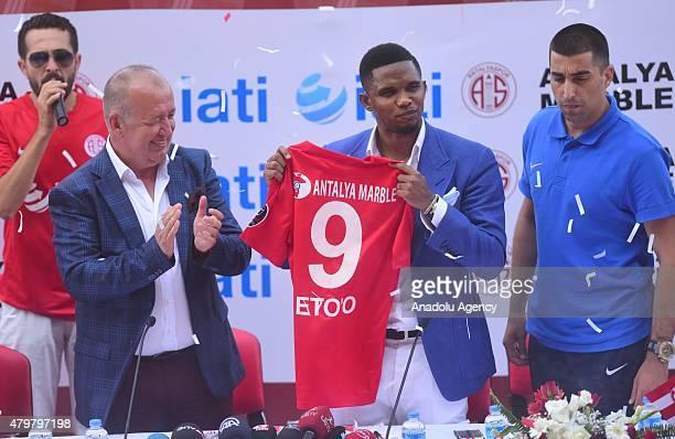 Cameroon forward Samuel Eto'o holds Antalyaspor's jersey after he joins Antalyaspor at Akdeniz University Stadium in Antalya south of Turkey after...