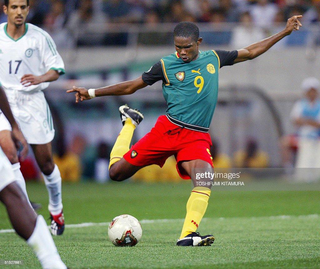 Cameroon forward Samuel Eto o C shoots to open t