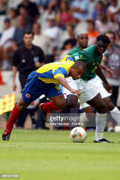 Cameroon Modeste Mbami and Colombia Jorge Lopez battle for the ball