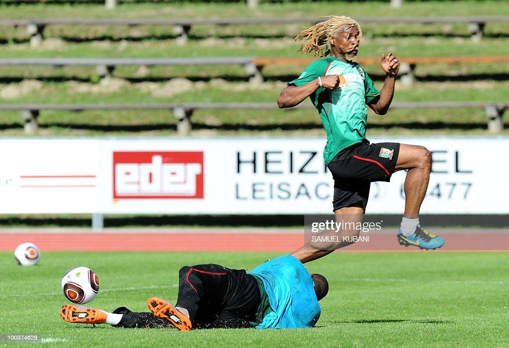Cameroon national football team player Rigobert Song (R) jumps over Hamidou Souleymano (L) during their practice session at their training camp in Lienz in Austria on May 24, 2010 prior to the FIFA World Cup 2010 in South Africa.