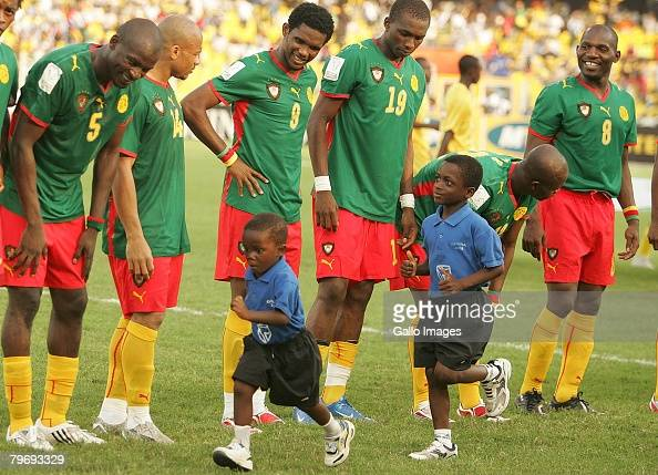 Cameroon players looks at the two boys running during the AFCON match final between Cameroon and Egypt held at the Ohene Djan stadium on February 10...