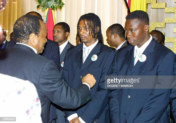 Cameroon President Paul Biya comforts Lions Indomptables captain Rigobert Song and goal keeper Idriss Kameni at a reception in the Yaounde...