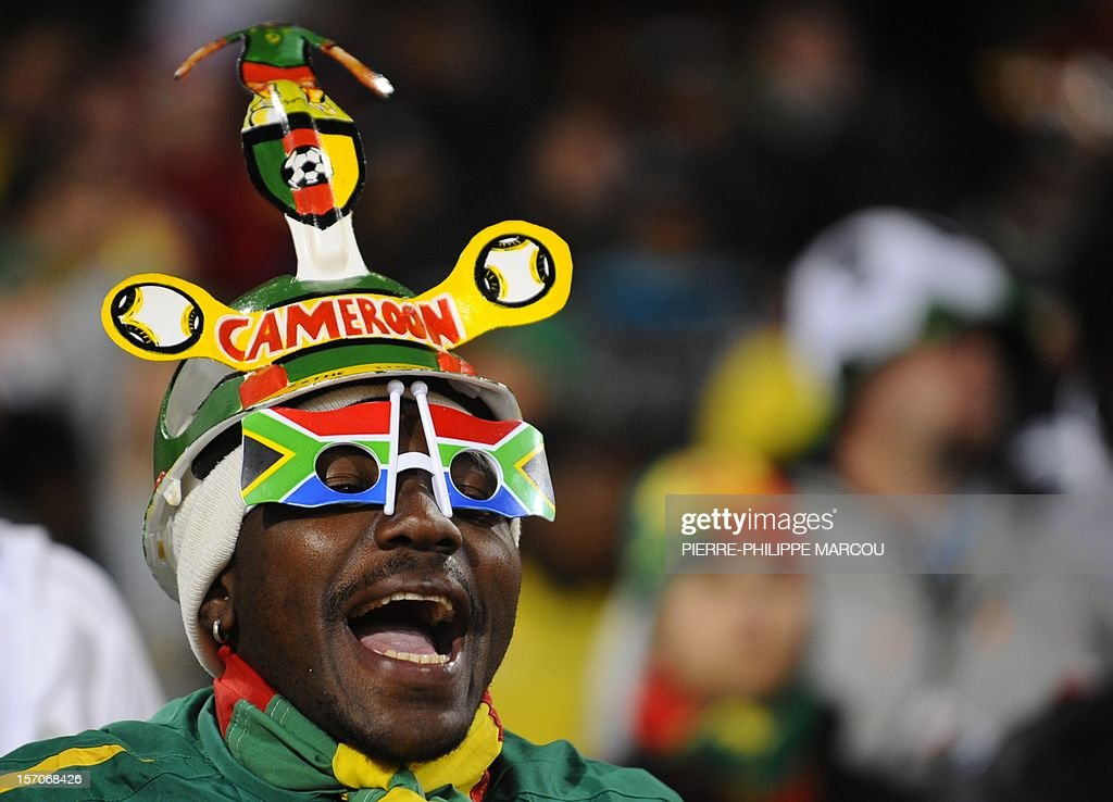 A Cameroon supporter wearing a Makarapa cheers prior to the start of the Group E first round 2010 World Cup football match Cameroon vs Denmark on...