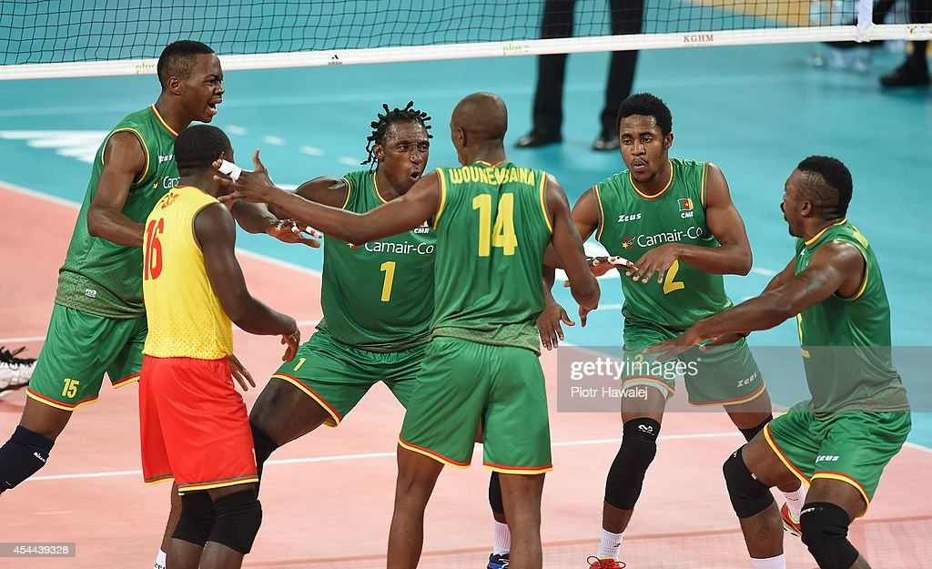 Cameroon team celebrate after winning a point during the FIVB World Championships match between Cameroon and Australia on August 31, 2014 in Wroclaw, Poland.