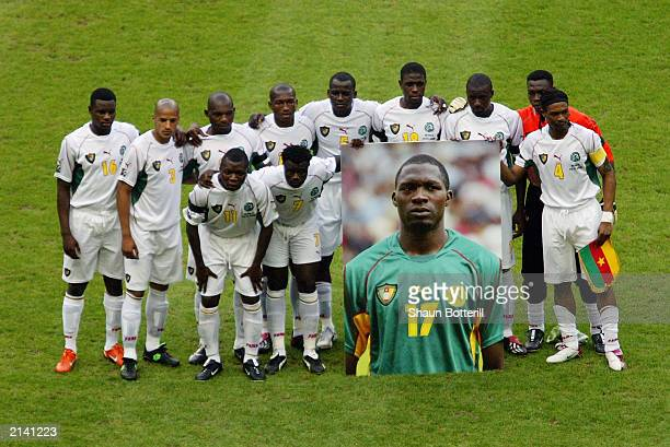 Cameroon team group with a photograph of teammate MarcVivien Foe who tragically died on the pitch in the previous match before the FIFA...