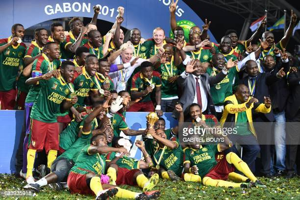 TOPSHOT Cameroon team players and Cameroon's Belgian coach Hugo Broos celebrate after beating Egypt 21 to win the 2017 Africa Cup of Nations final...