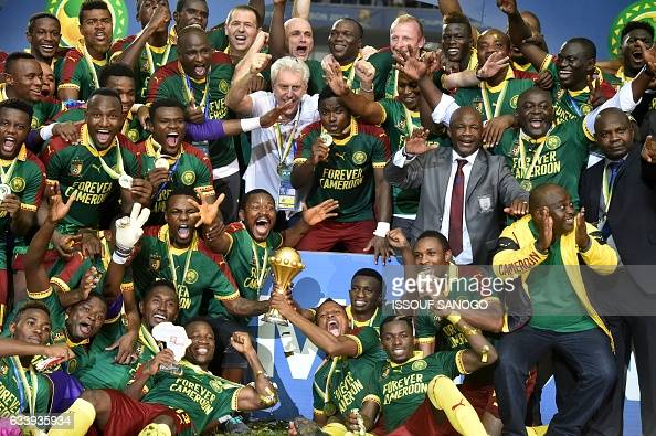 Cameroon team players and Cameroon's Belgian coach Hugo Broos celebrate after beating Egypt 21 to win the 2017 Africa Cup of Nations final football...