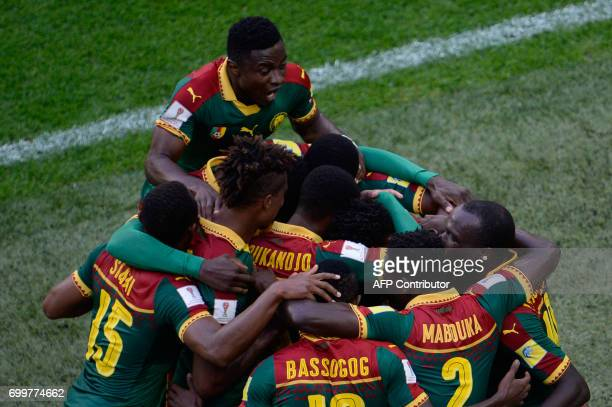 TOPSHOT Cameroon teammates celebrate the match's first goal during the 2017 Confederations Cup group B football match between Cameroon and Australia...