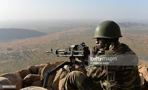 A Cameroonese soldier holds a position on Febuary 16 2015 near the village of Mabass northern Cameroon Cameroon's army announced on February 17 2014...