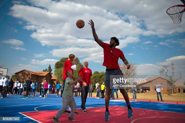Cameroonian born NBA player Joel Embiid of the Philadelphia 76ers and other NBA players from different countries interact with children during a...