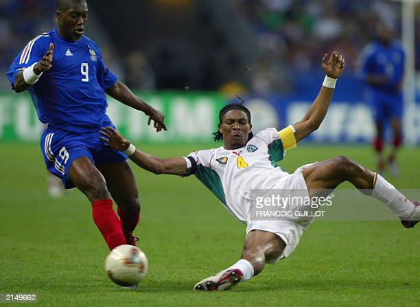 Cameroonian defender and captain Rigobert Song vies with French forward Djibril Cisse during their soccer Confederations Cup final match 29 June 2003...