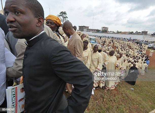 Cameroonian faithfuls queue outside of the Amadou Ahidjo stadium to attend a mass given by Pope Benedict XVI in Yaounde on March 19 the third day of...