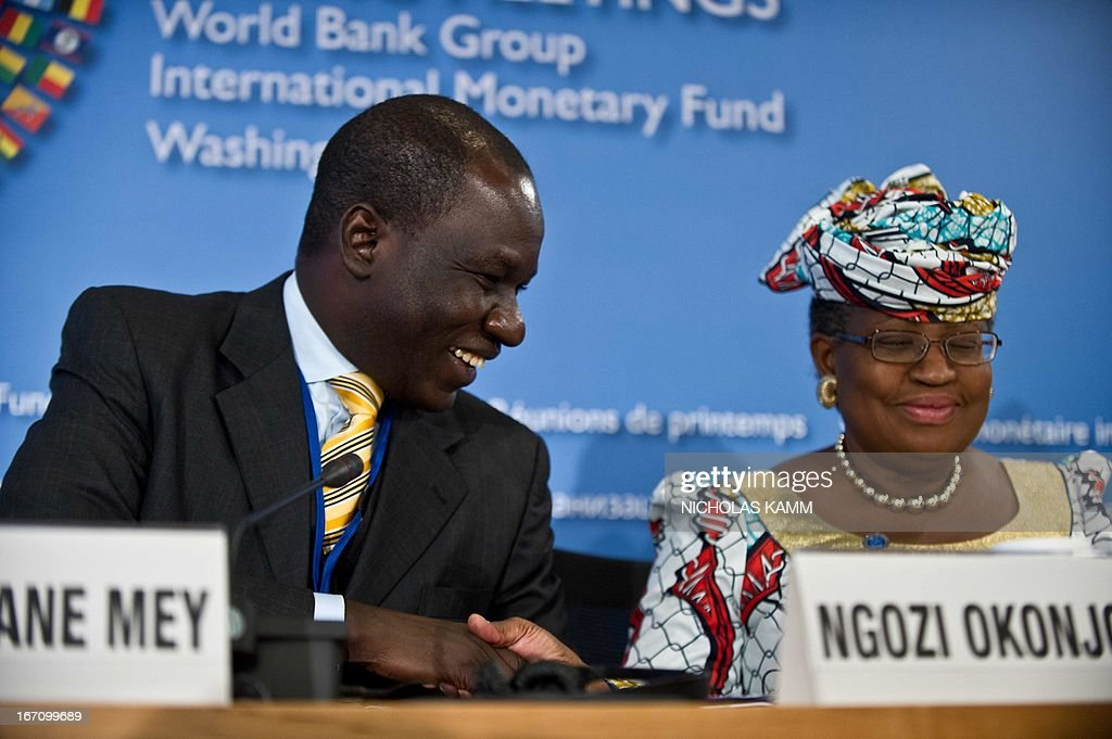 Cameroonian Finance Minister Alamine Ousmane Mey shakes hands with Nigerian counterpart Ngozi Okonjo-Iweala as he speaks at a press conference of African finance ministers at the 2013 World Bank/IMF Spring meetings in Washington on April 20, 2013. AFP PHOTO/Nicholas KAMM