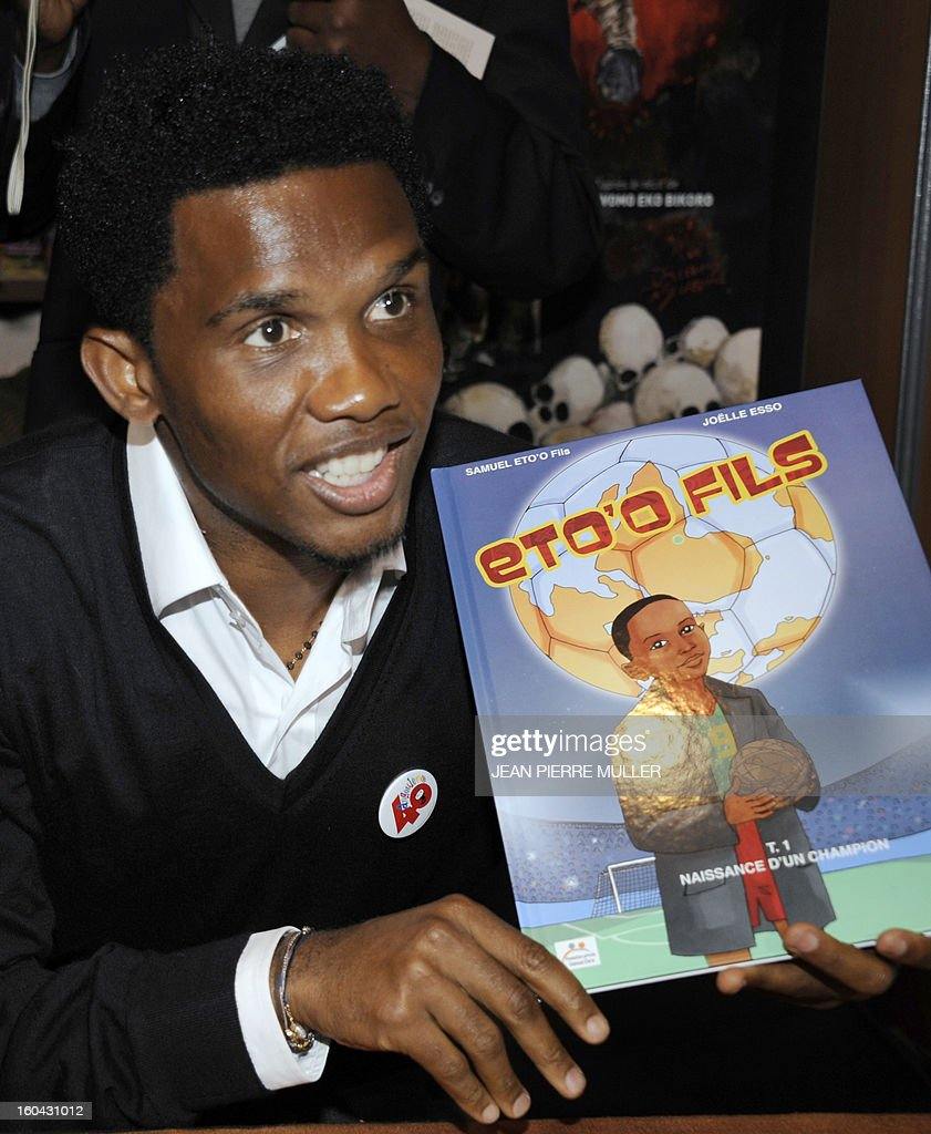 Cameroonian footballer Samuel Eto'o poses with a comic book about his life during the Comic book festival of Angouleme on January 31, 2013 which opened today.