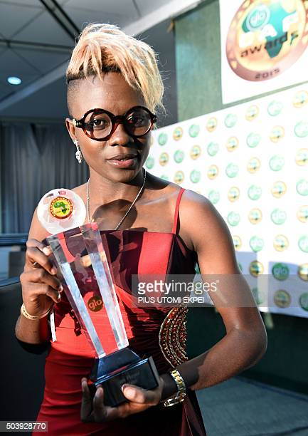 Cameroonian forward Gaelle Enganamouit holds trophy awarded her as Women's Player of the Year during the African Footballer of the Year Award in...