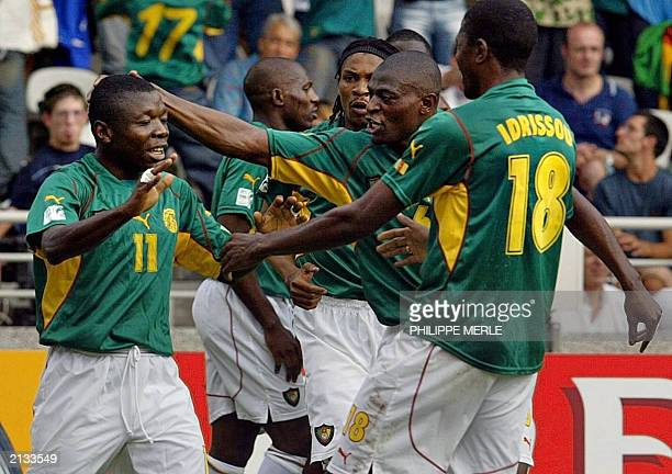 Cameroonian forward Pius Ndiefi is congratulated by his teammaet after his goal during the semifinal soccer Confederations Cup match against Colombia...