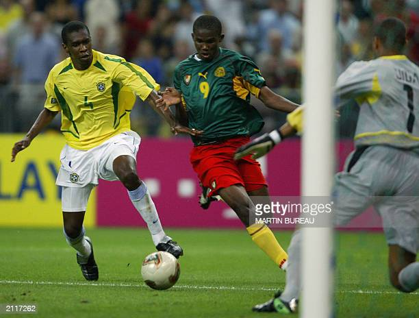 Cameroonian forward Samuel Etoo vies with Brazilian defender Juan during their soccer Confederation Cup first round match 19 June 2003 at Stade de...