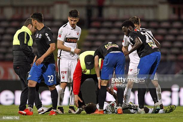 Cameroonian international Patrick Ekeng lies on pitch after he collapsed during the football match between Dinamo Bucharest and Viitorul Constanta in...