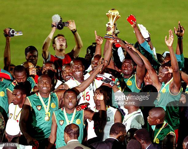 Cameroonian players jubilate after winning the final of the African Nations Cup against Senegal 10 February 2002 in Bamako Final score was 00 with...